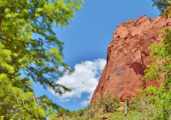 Red cliffs framed by a blue sky.