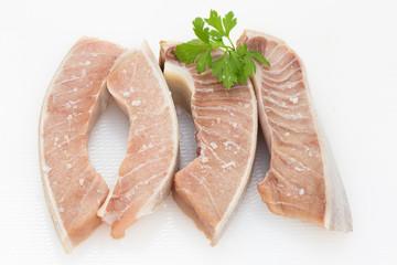 fresh tuna belly on a table season with sea salt flakes