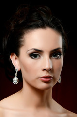 The beautiful woman in jewelry earrings
