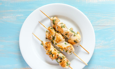 Grilled chicken skewers with fresh lettuce