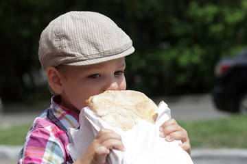 Child eating loaf of bread