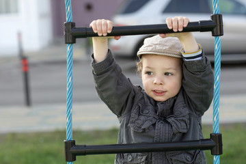 Child on a rope ladder