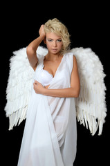 The beautiful girl in a suit of a white angel