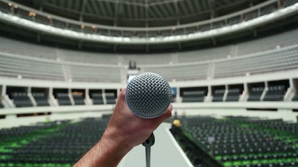 Hand holding microphone at sound-check before a show