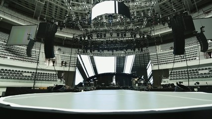 Lights and sound set-up at concert.  Black, white, gray tones