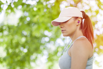 beautiful young woman listening to music during sports activity