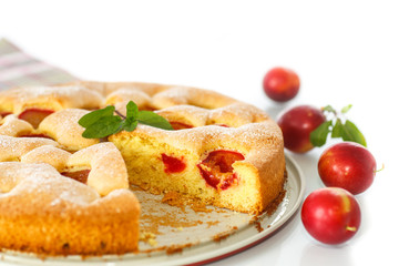Biscuit cake with cherry plums