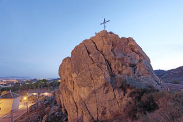 Christian cross on top of a rock in Lorca, Spain