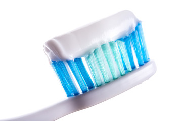 toothbrush with toothpaste on white background