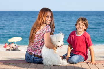 Attractive young woman and boy at the seaside.