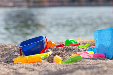 Children's beach toys - buckets, spade and shovel on sand on a s