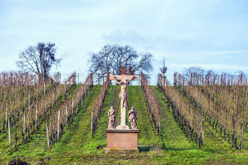 sandstone crucifix in the vineyard