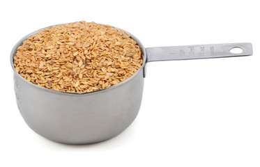 Golden linseed in an American cup measure