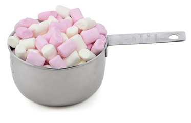 Pink and white mini marshmallows in an American cup measure