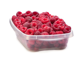 Raspberry in plastic container