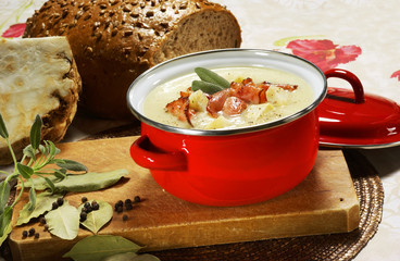 Celery soup with sage and bacon in a pan