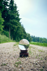 Crystal ball on a dirt road