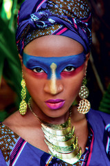beautiful black woman with color makeup with gold  ornamentation
