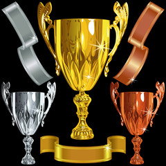 Winning gold, silver, bronze cups and ribbbons
