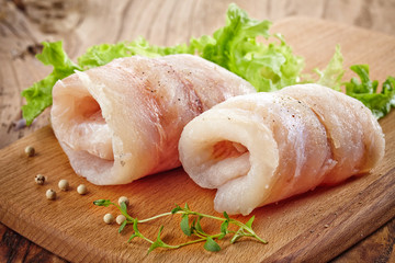 raw hake fish fillet rolls