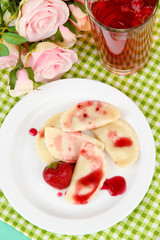 Tasty  sweet dumplings with fresh strawberry