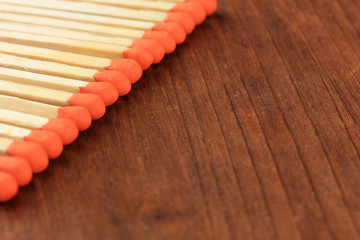 Long matches for fireplace, on wooden background