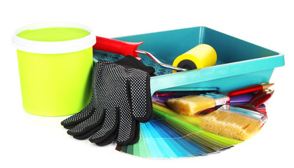 Plastic bucket with paint, roller, brushes and bright palette