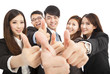 happy successful business team with thumbs up