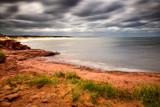 Atlantic Ocean stirring as hurricane approaches Cavendish Beach poster