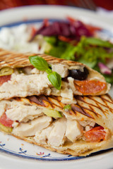 Wrap tortilla chicken olives basil salad tomato