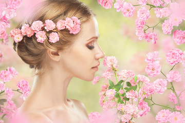 young beautiful woman with pink flowers in her hair