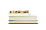 Fototapety phonics word on wood stamps and books