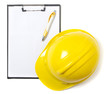 Blank clipboard paper and hard hat isolated on white background
