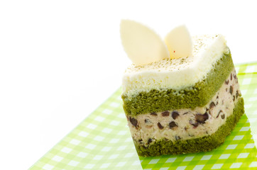 Matcha green tea cake isolated on white background