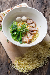 Noodles bowl on wooden background