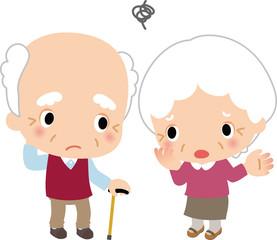 悩んでいる高齢の夫婦