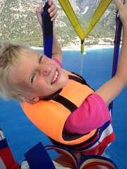 Happy boy enjoying parasailing on summer vacation
