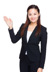 Asian business woman with open hand palm