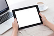Leinwanddruck Bild - female hands holding a tablet with isolated screen against the b