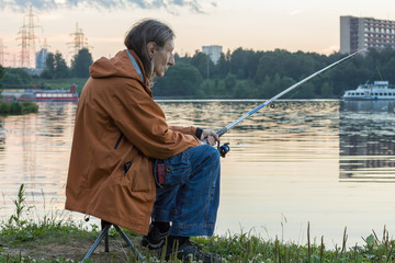 A man fishing on a fishing rod