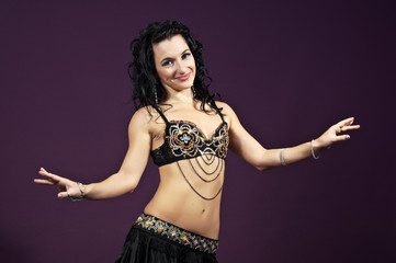 Young brunette belly dancer