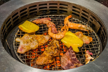 Grilled chickens, pork, beefs, shrimps and sweet pepper