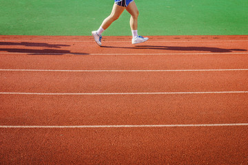 An athlete is running on racetrack