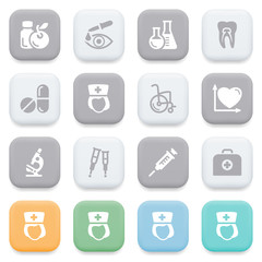 Medical icons on color buttons.