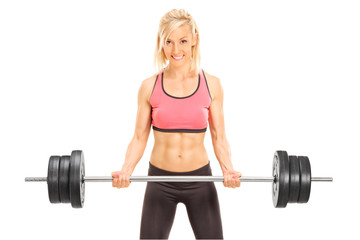 Female bodybuilder holding a barbell