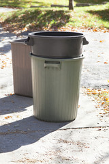 Dustbins outside against in the street.