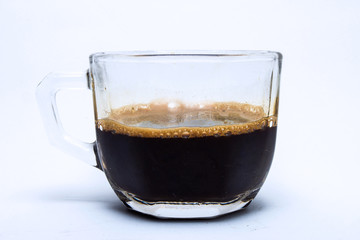 coffee in glass cup, isolated on white background.