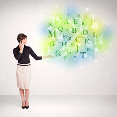 Business women with glowing letter concept