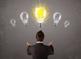 Business person having an idea light bulb concept