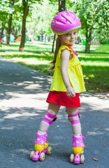Girl goes rollerblading in the park